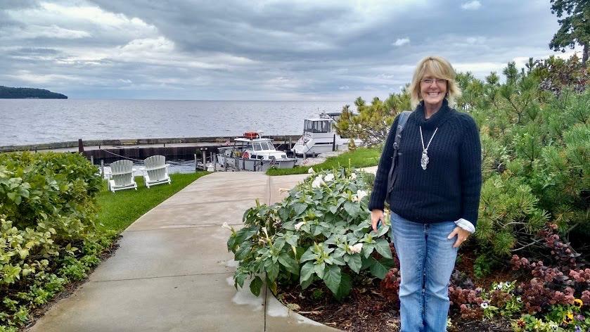Danelle in the garden of The Shoreline Restaurant